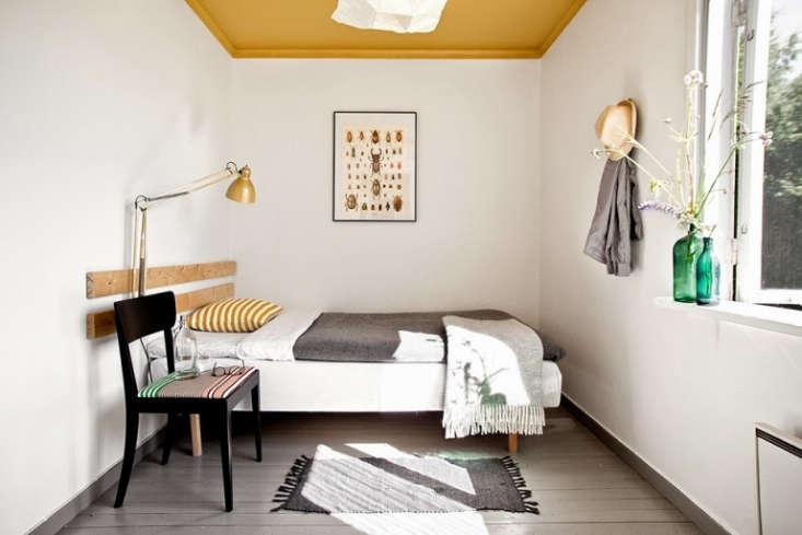 sagverket sawmill bedroom yellow ceiling sweden
