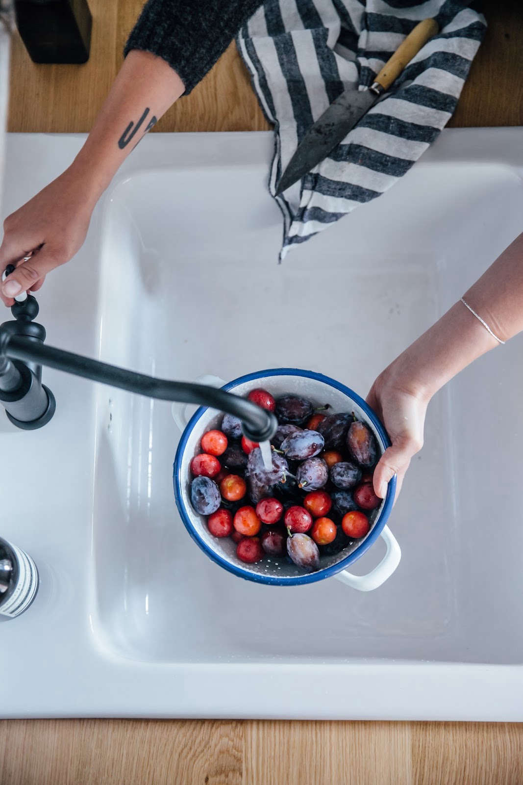 Ikea farmhouse sink photographed by Our Food Stories   Remodelista