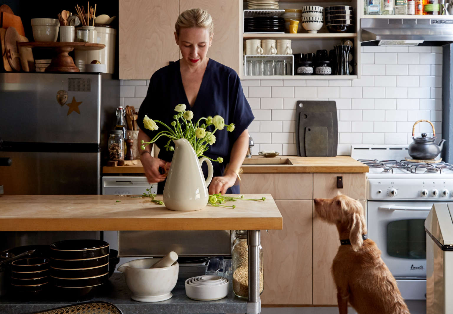 Renata Bokalo at home in her DIY kitchen remodel in her NYC rental, Kate Sears photo