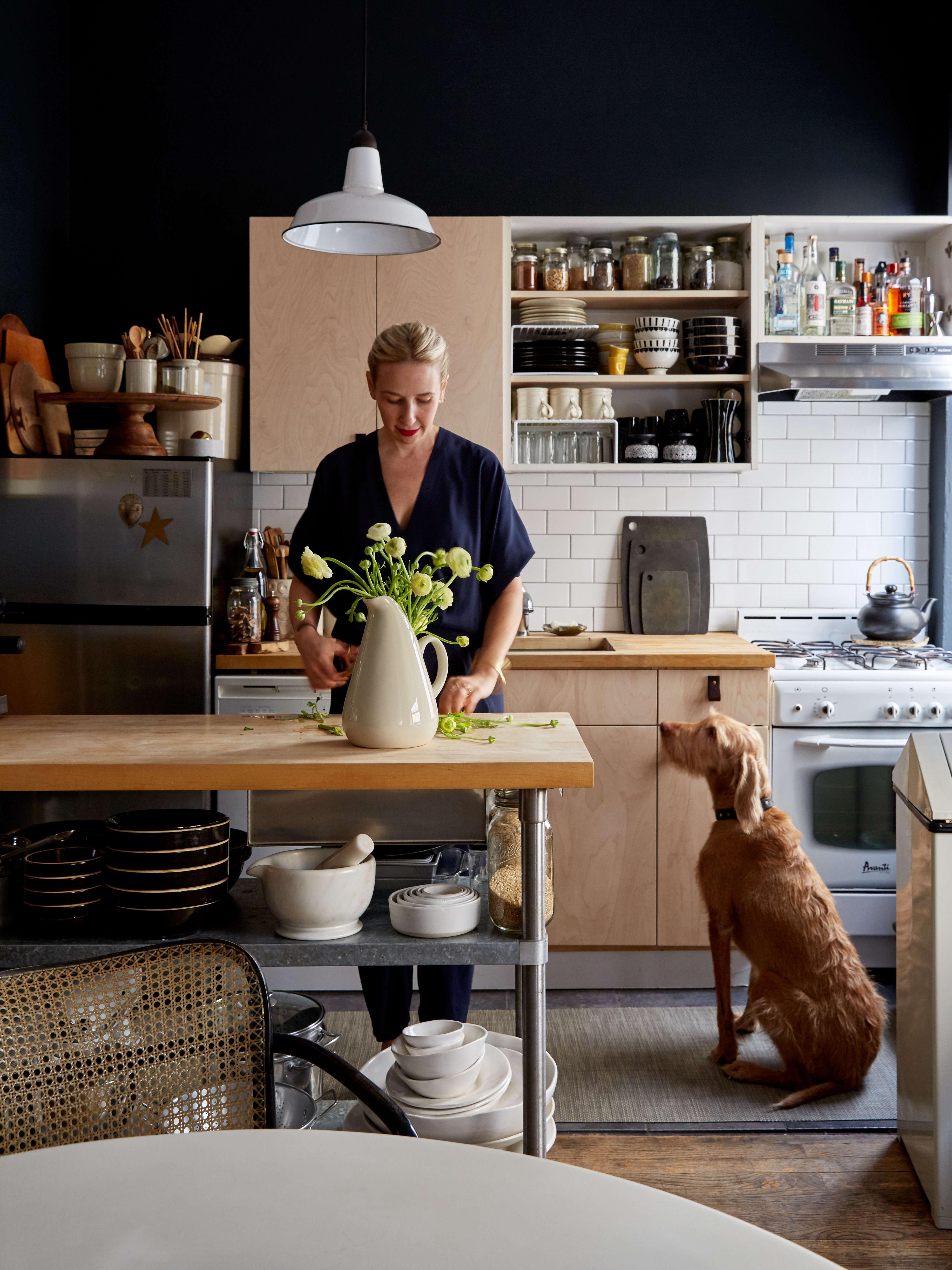 Renata Bokalo at home in her DIY kitchen remodel in her rental apartment