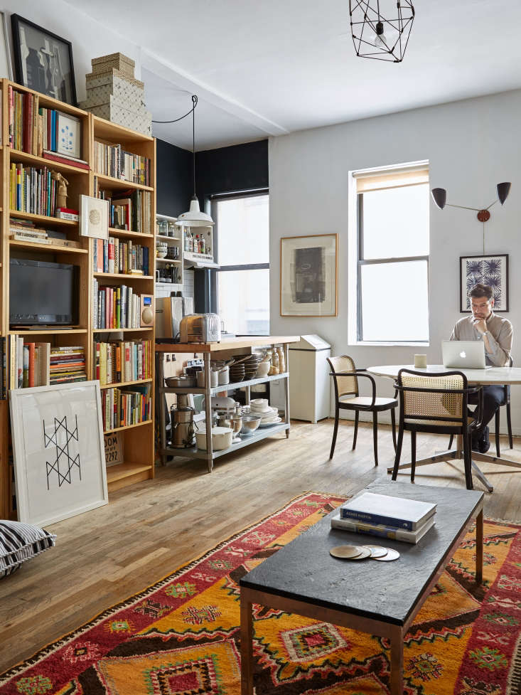 A petite 700-square-foot New York City apartment manages to house all of its owners belongings thanks to some clever storage solutions. See more in 'How to Live With Stuff and Little Space': 17 Affordable Tips from an NYC Creative Couple. Photograph by Kate Sears.