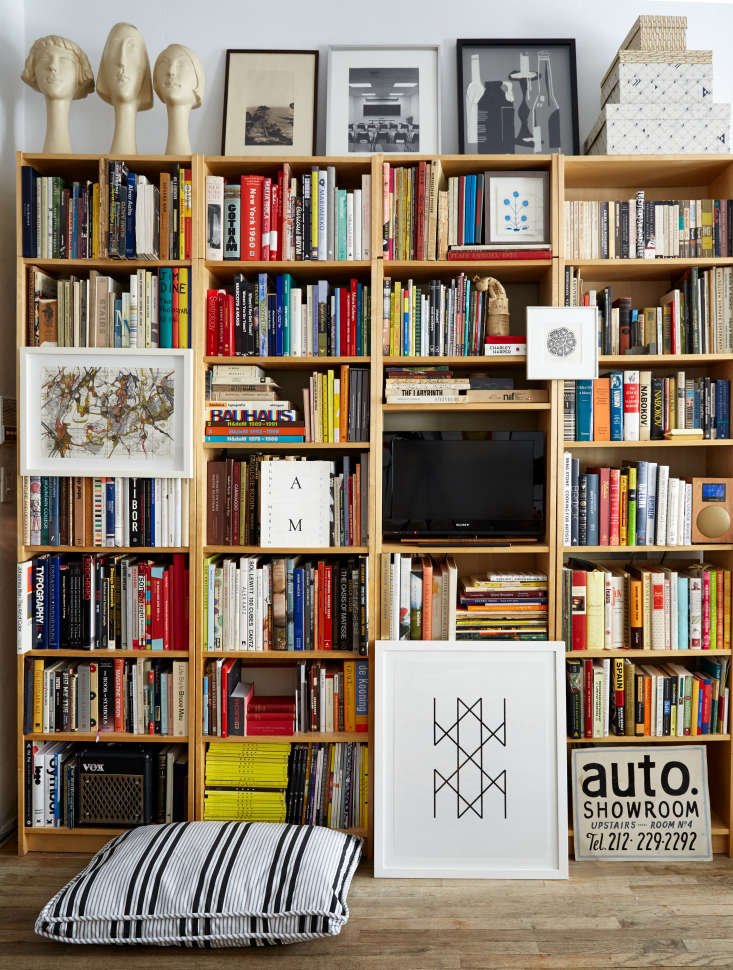 Four Billy Bookcases placed side by side, give the illusion of custom bookshelves; $59 each. Photograph by Kate Sears, fromSmall-Space Solutions: 17 Affordable Tips from an NYC Creative Couple.