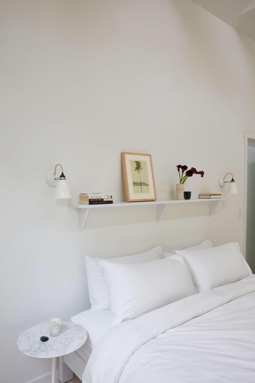 Lisa Jones' Shelter Island House Master Bedroom Shelf Above Bed, Photo by Jonathan Hokklo