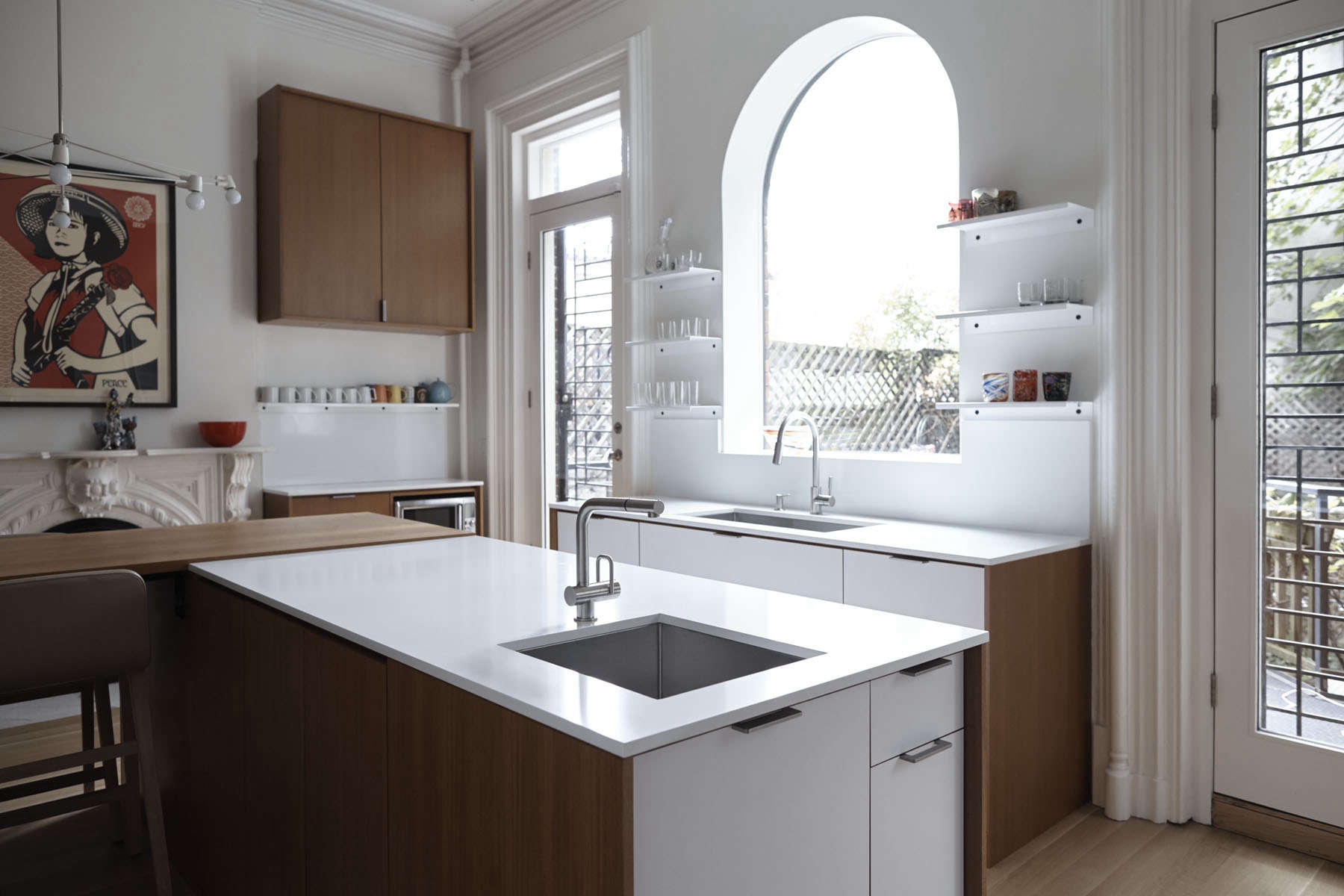 A preserved historic setting for a modern kitchen remodel by architect Shauna McManus and Henrybuilt. The countertops are Caesarstone, the cabinets are teak and white laminate