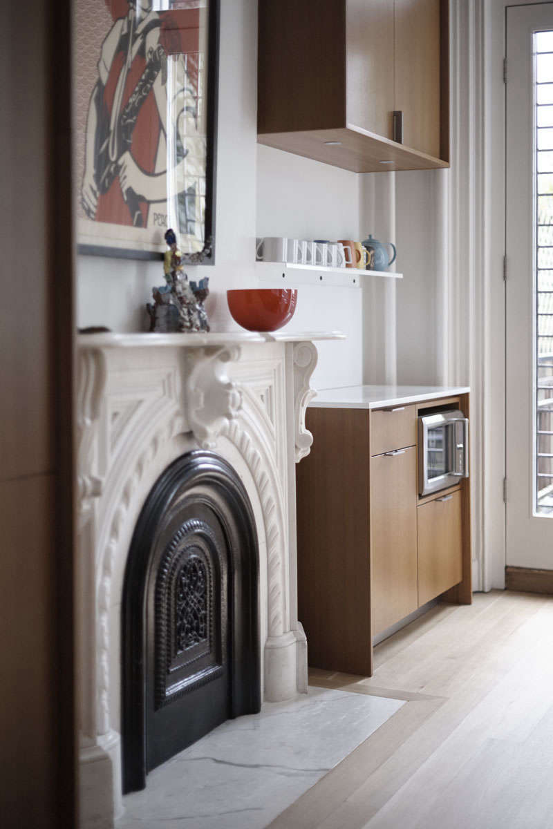 Microwave fitted into a kitchen cabinet in a Brooklyn brownstone remodel by architect Shauna McManus and Henrybuilt