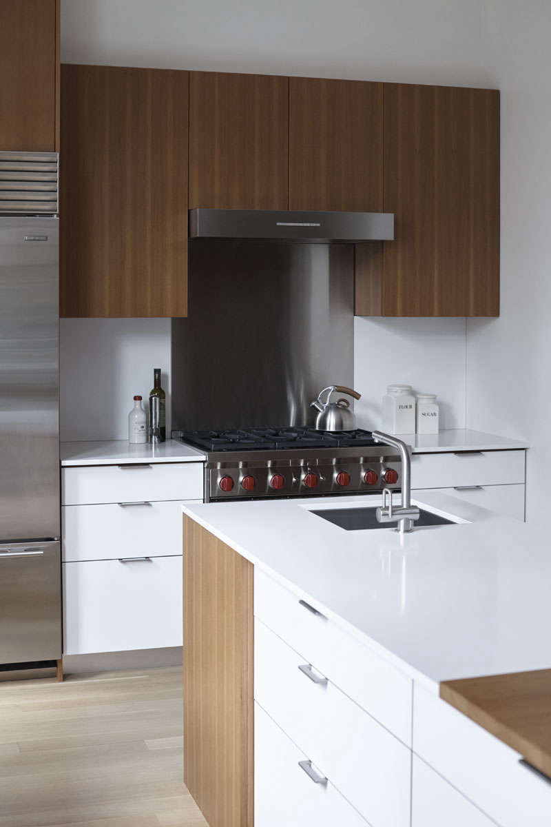 Wolf range and teak and laminate cabinets in a kitchen remodel by architect Shauna McManus and Henrybuilt