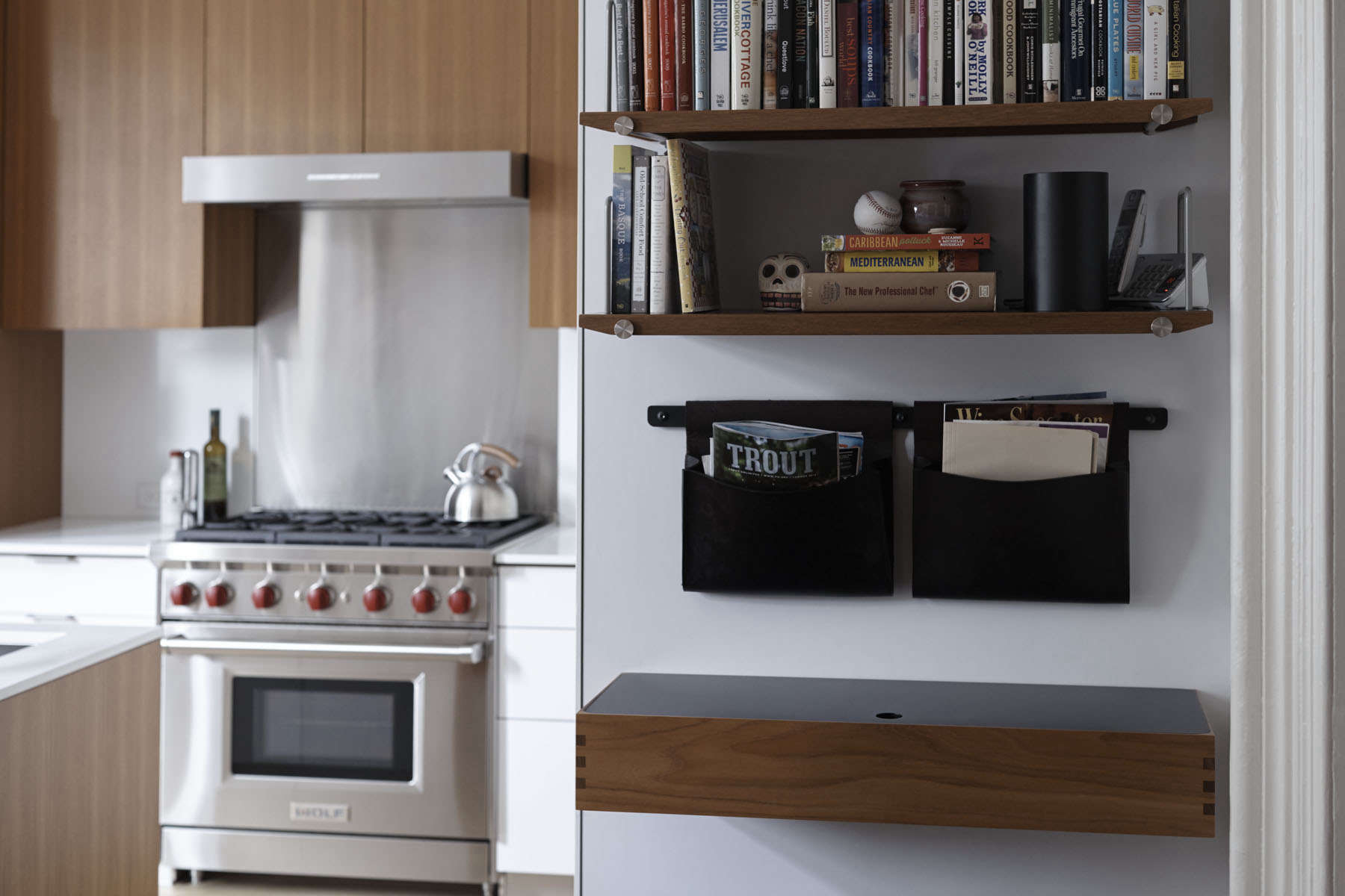 Henrybuilt Opencase shelves, leather hanging pouches, and a wall desk in a Brooklyn kitchen remodel