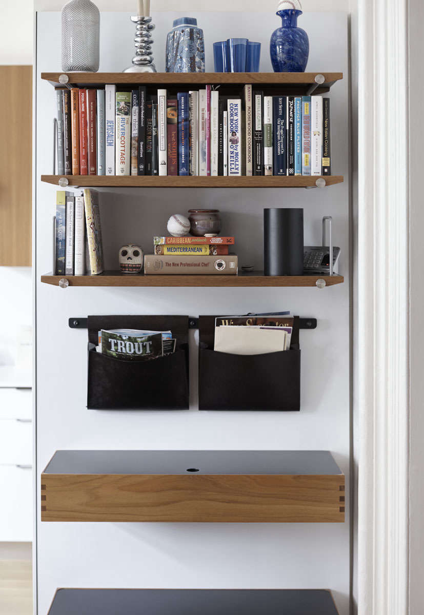 A teak desk, leather hanging pouches, and steel-mounted teak shelves from Henrybuilt's Opencase storage line