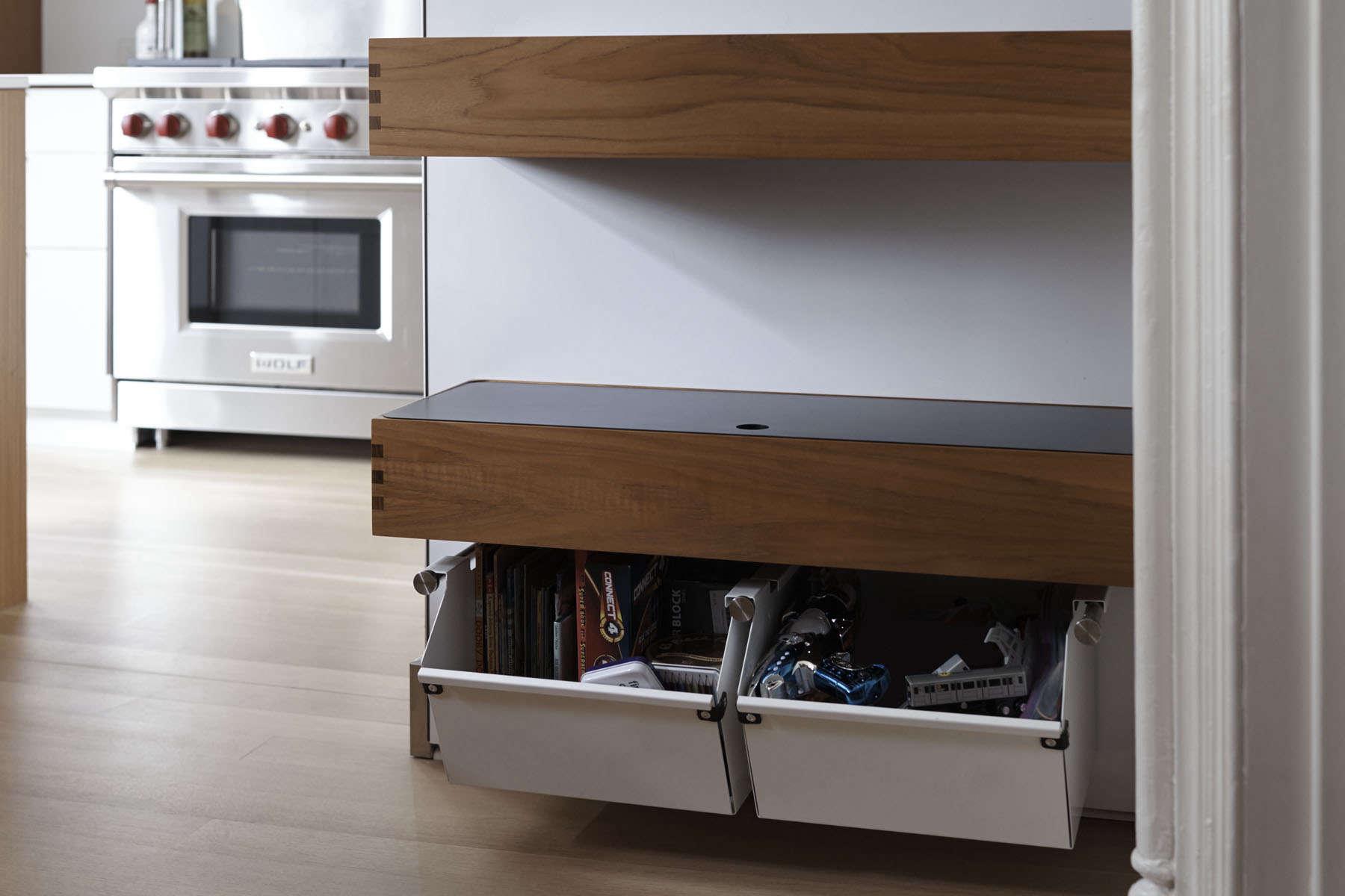 Powder-coated steel bins, a teak desk, and shelves from Henrybuilt's Opencase storage line