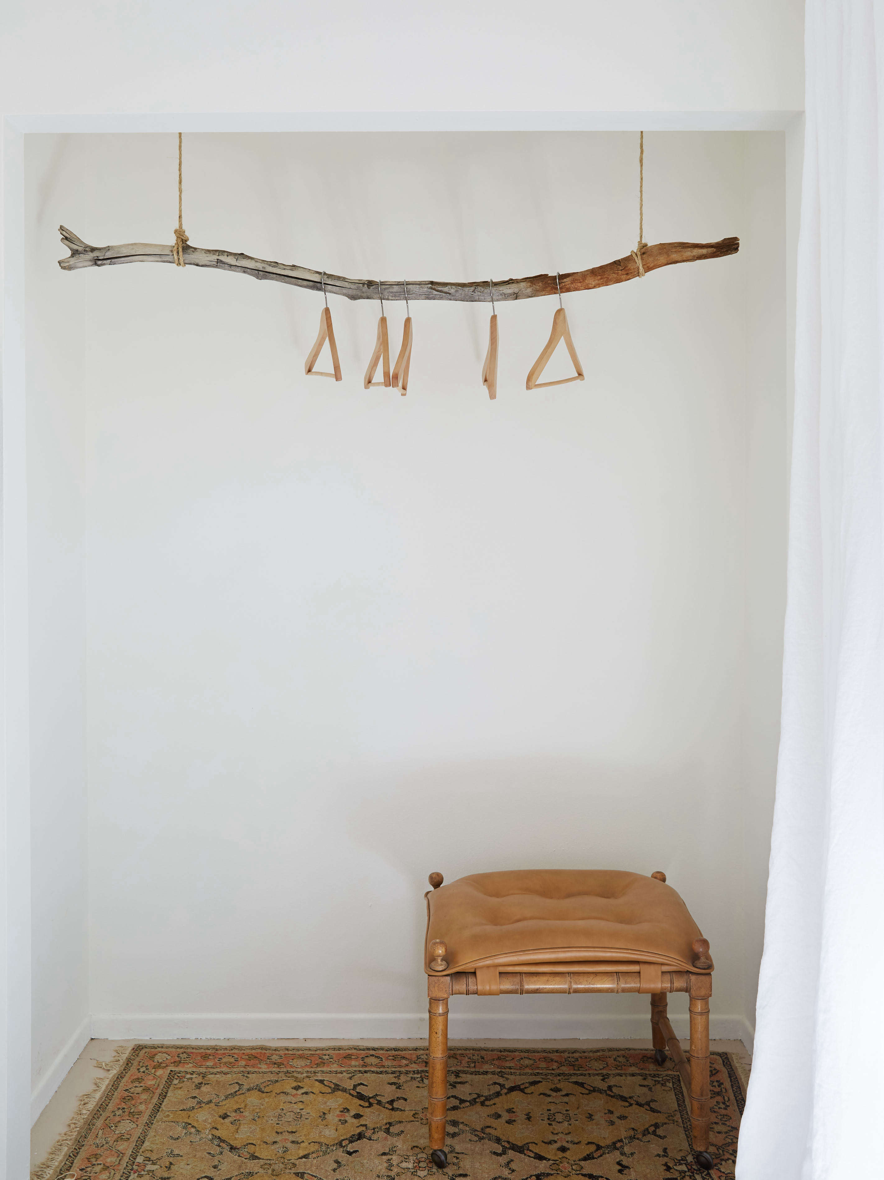 DIY closet made from a hanging branch at the Joshua Tree Casita Air Bnb, Kate Sears photo