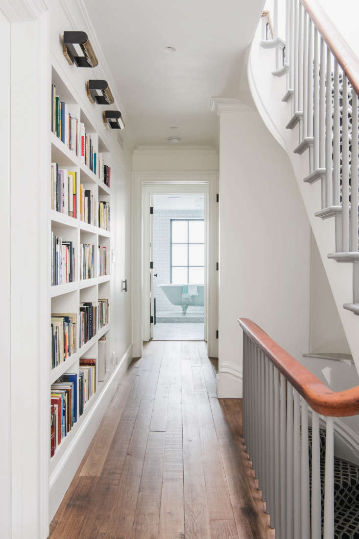 A built-in bookcase beautifully maximizes storage space in this narrow hallway. SeeAn Unfussy Brooklyn Townhouse Remodel from Architect Elizabeth Roberts.Photograph byDustin Aksland.
