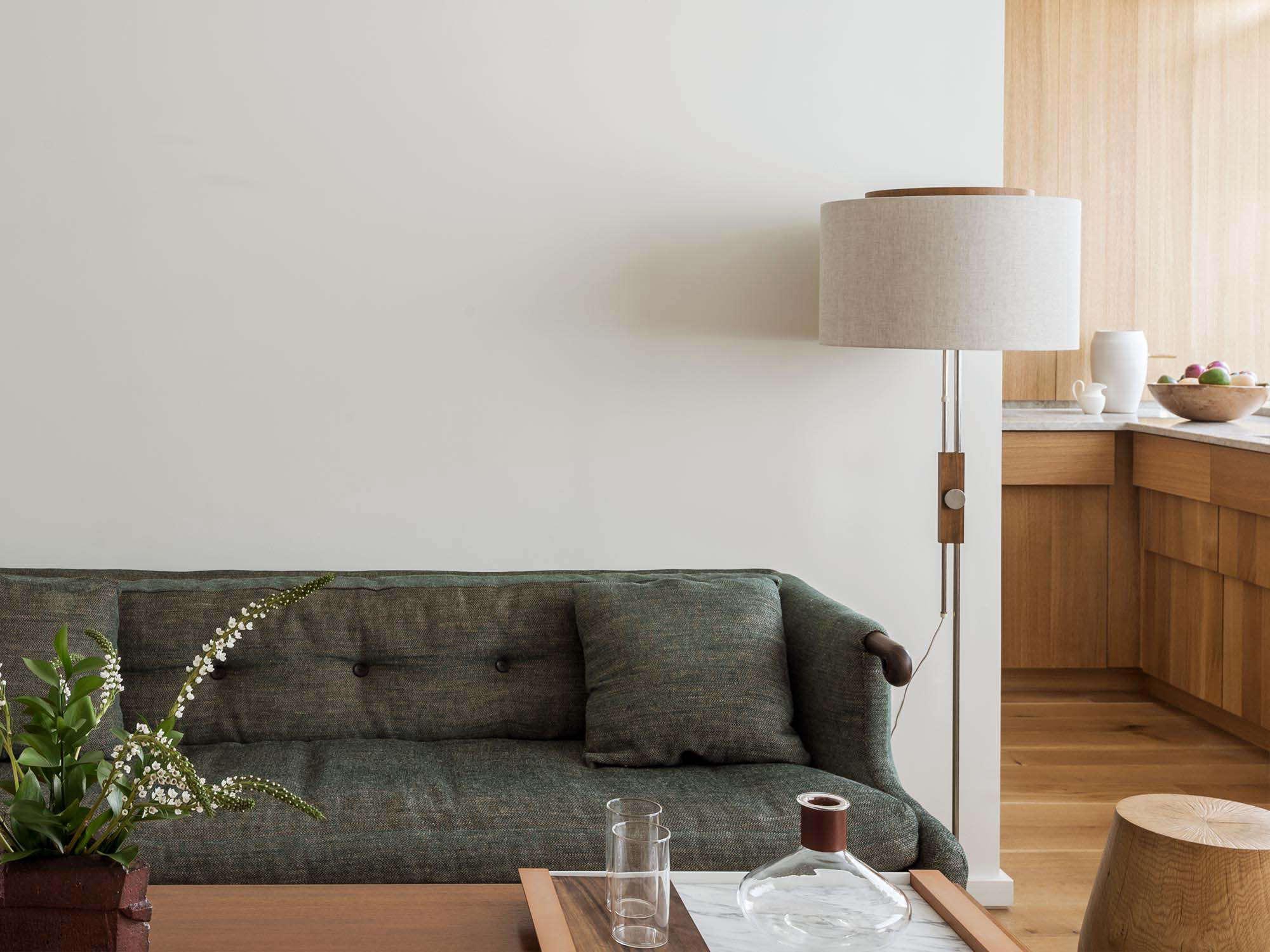 Workstead NYC one-bedroom remodel combined living room-kitchen with custom oak millwork, BDDW sofa, Matthew Williams photo