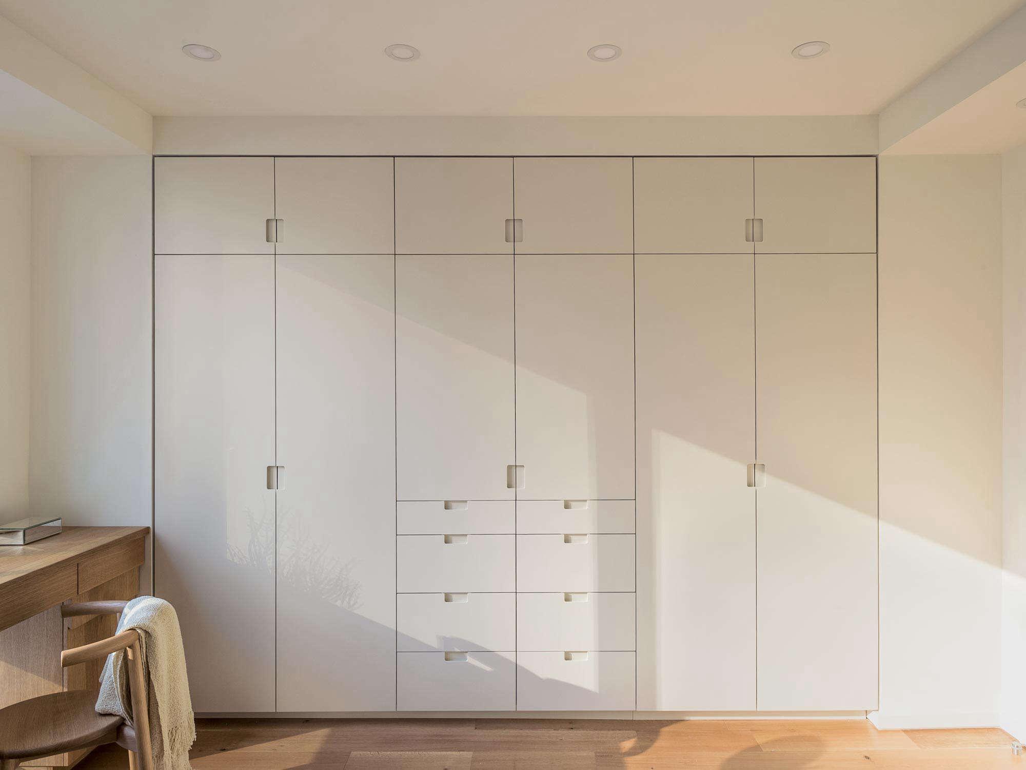 Workstead-Riverside-Blvd-remodel-bedroom-custom-built-in-closet-wall-flush-pivot-doors-9