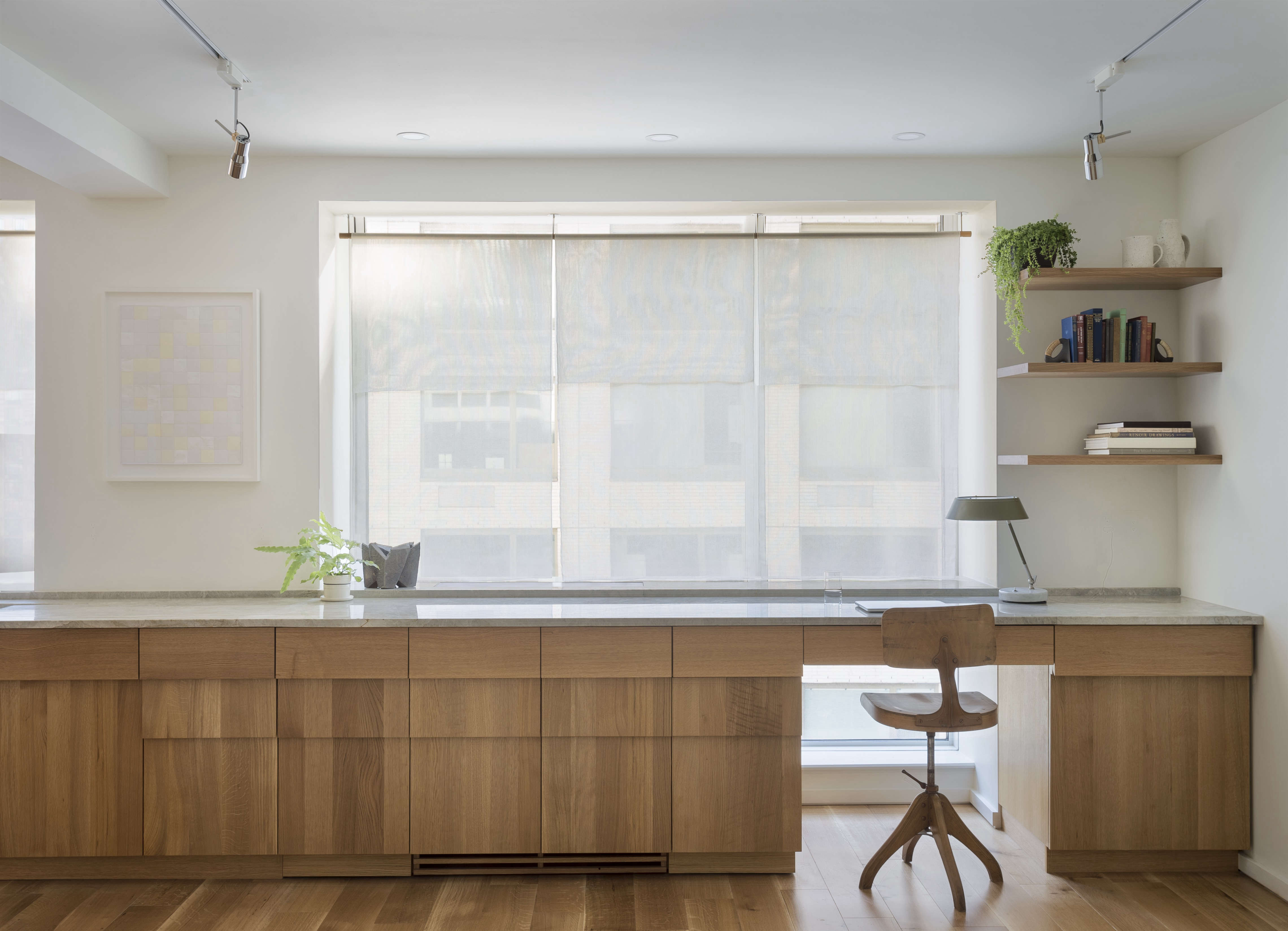 New York apartment home office with custom stepped oak cabinets, a design by Workstead , Matthew Williams photo