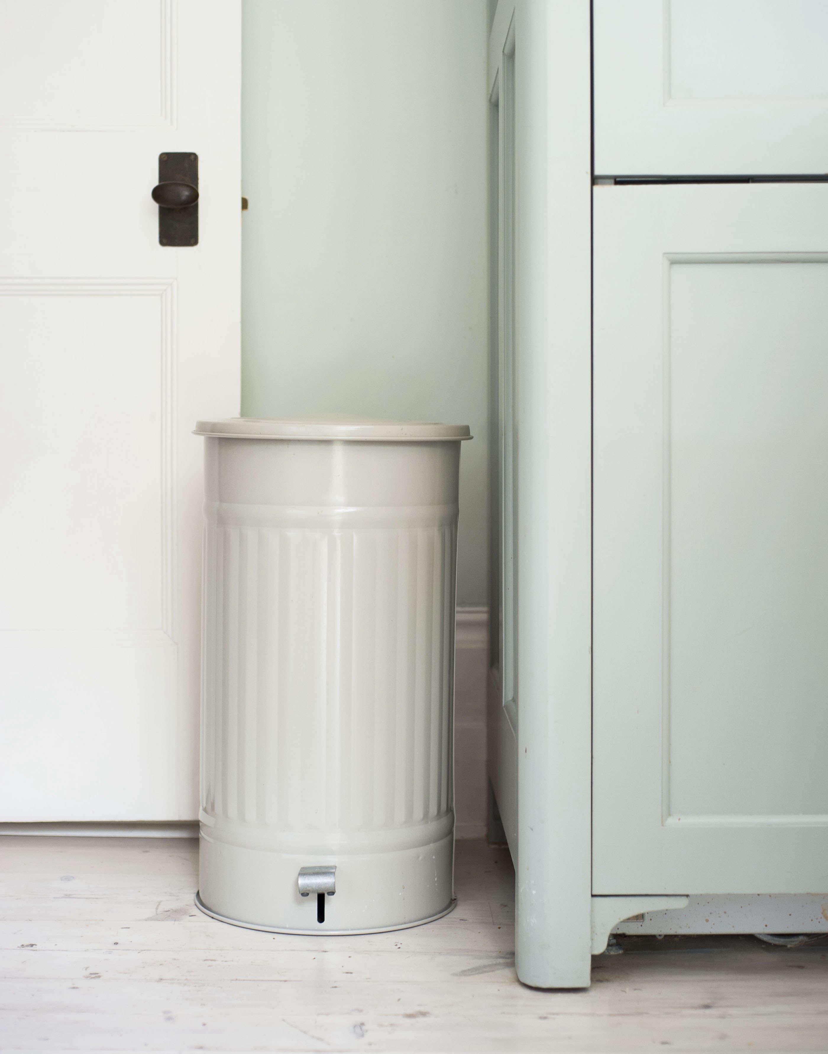 Gorgeous garbage: Enameled steel kitchen pedal bin trash can from Garden Trading in Michelle McKenna's London townhouse. Matthew Williams photo.