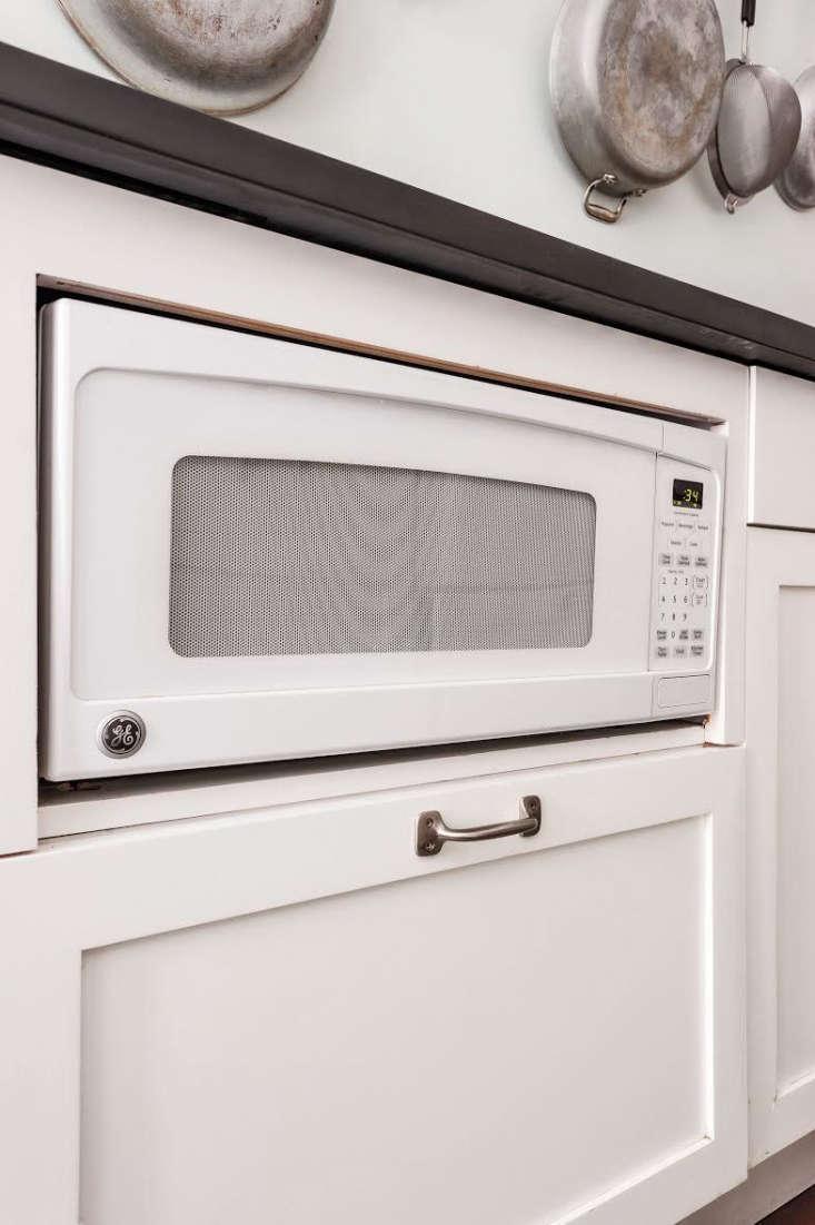 Microwave Under Counter Ann DeSaussure Davidson and Scott Davidson Galley Kitchen, Photo by Matthew Williams for Remodelista Book