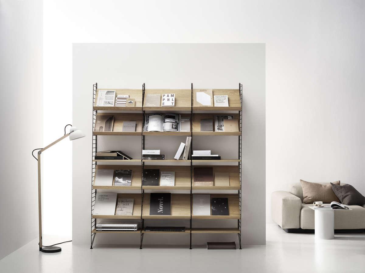String System's modular shelving includes angled magazine/book shelves.