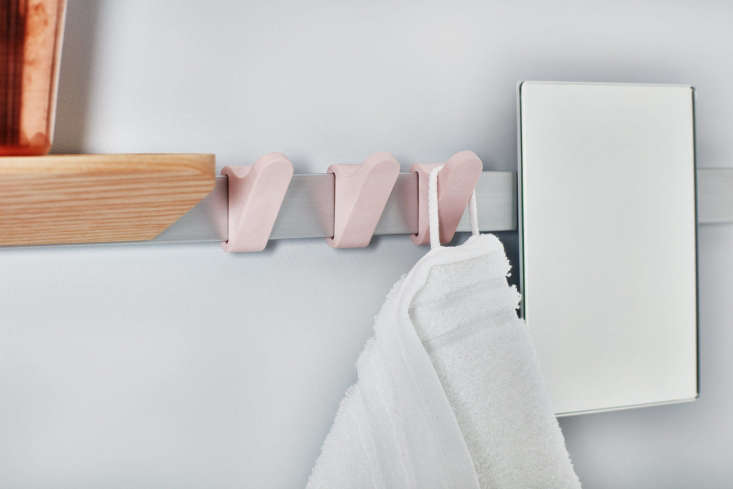 The plastic hooks can be slidalong the rail and positioned where needed.