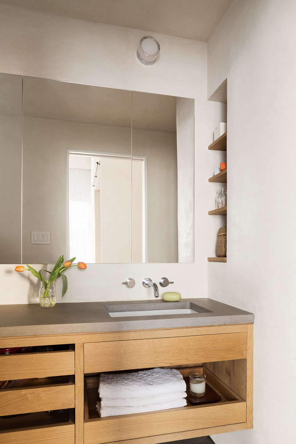 Plaster walls and open drawers in a Gramercy Park apartment remodel