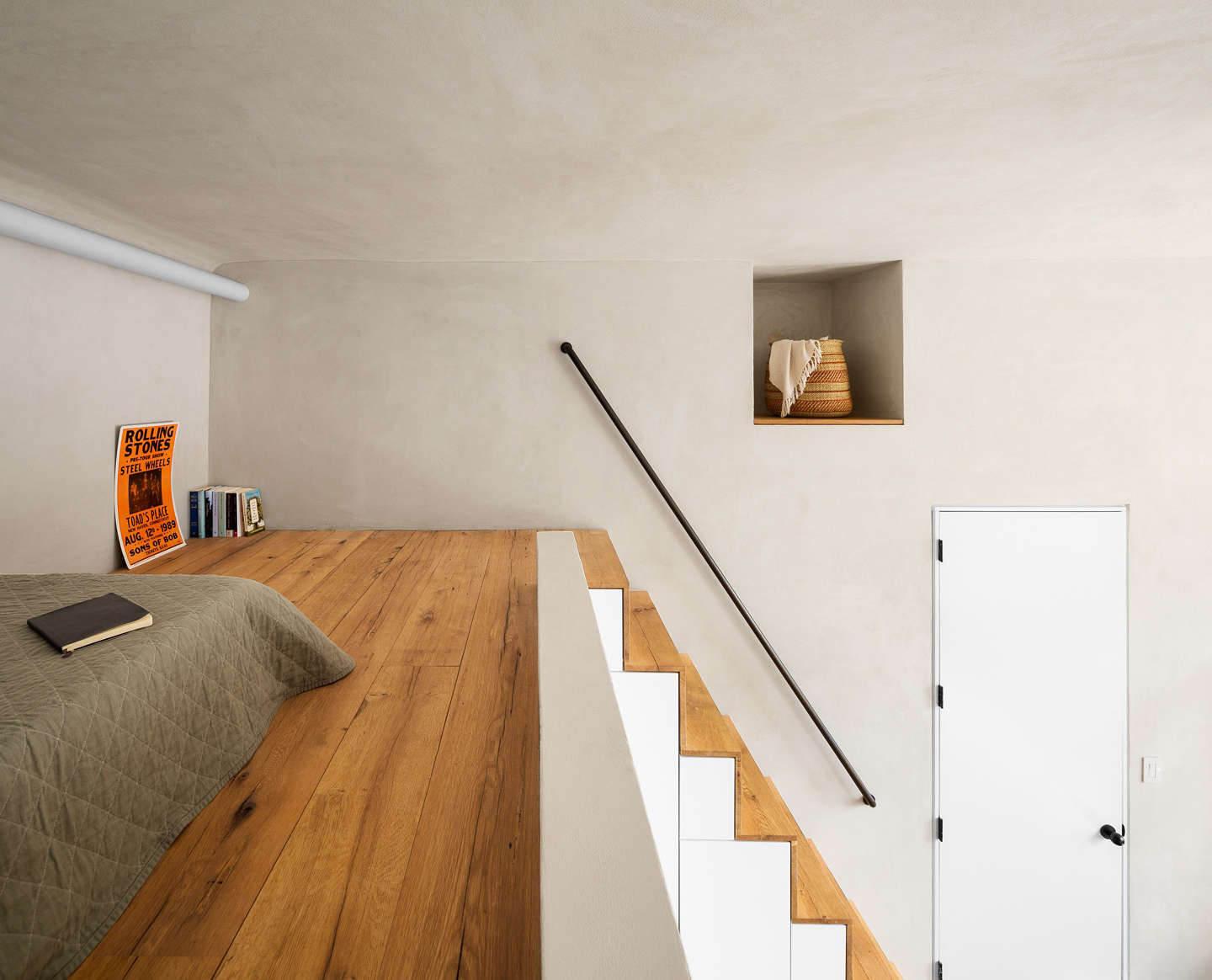 Lofted sleeping space in a Gramercy Park apartment remodel