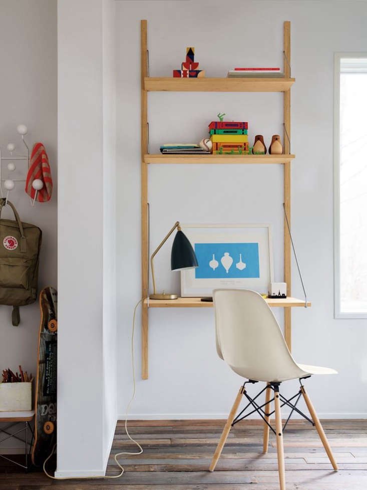 The soaped oak with raw brass Royal System Shelving Unit is $1,670 from Design Within Reach.