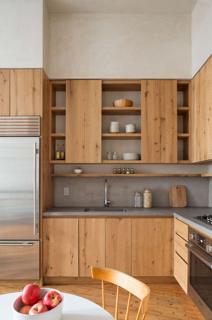 The kitchen countertops and backsplash are made of concrete, and the custom cabinetry is reclaimed white oak. Lee chose the combinationfor its organic modern look.