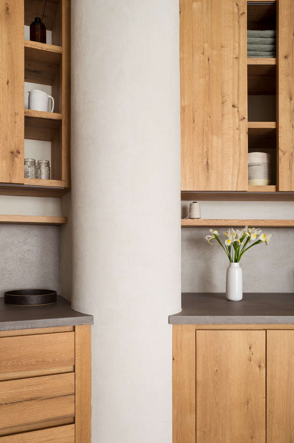 Kitchen of a Gramercy Park apartment remodel with plaster walls and oak cabinets