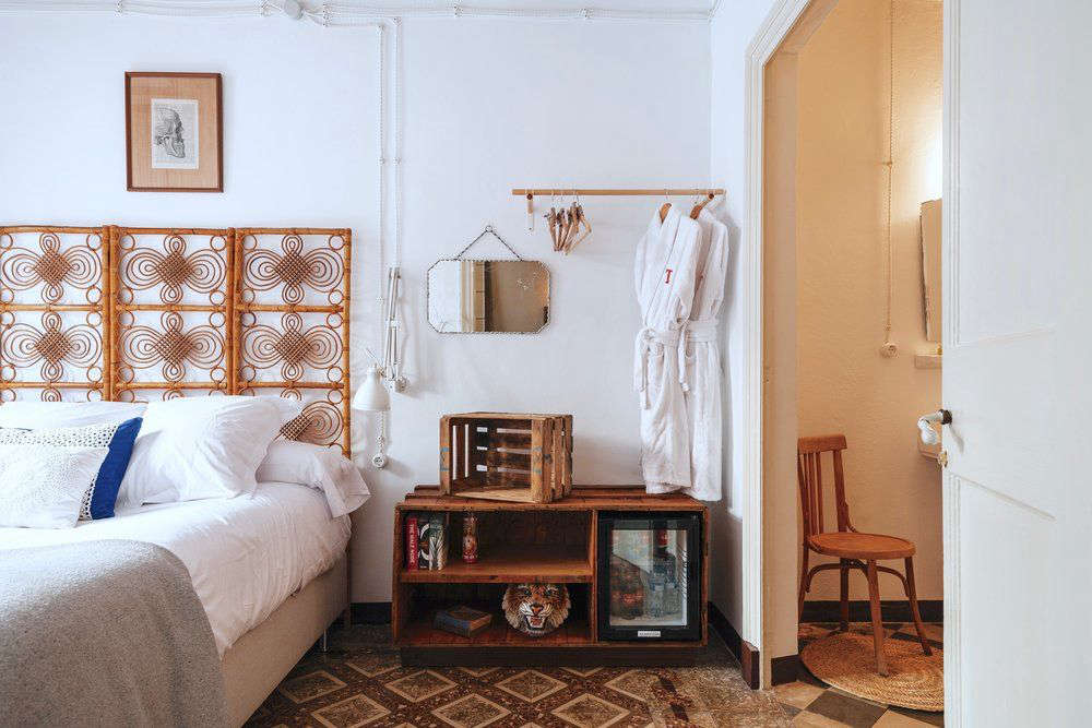 The open wardrobe trend isn't just restricted to modern hotels; an exposed clothes rail looks just as apropos in a rustic room at Casa Telmo in Menorca, Spain.