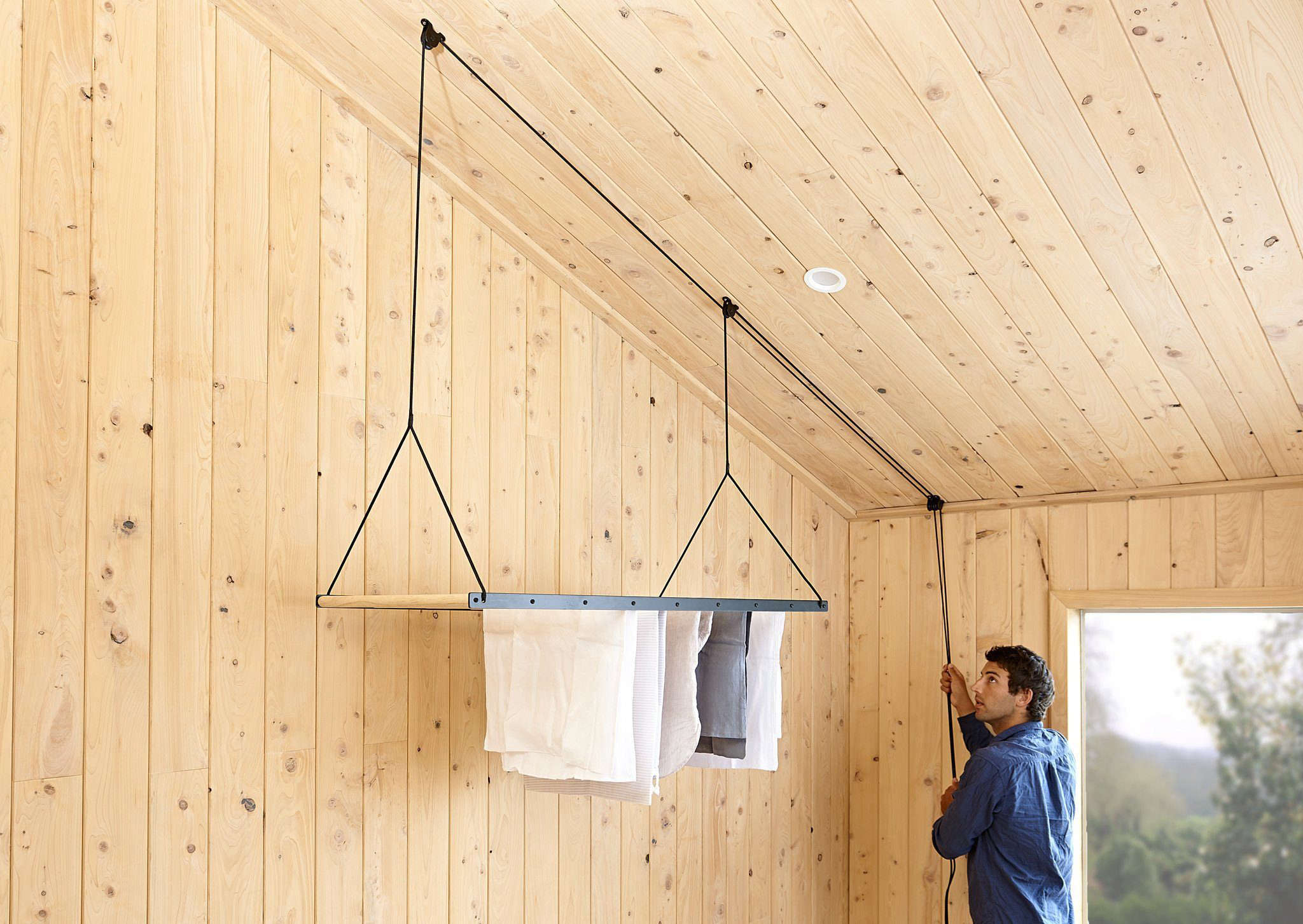 George and Willy Laundry Rack in Wood Paneled Room