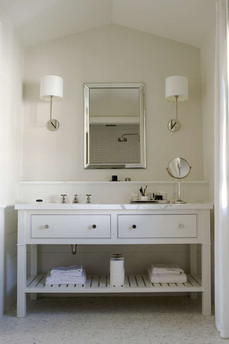 The vanity countertop in the master bathroom is statuary marble. The faucet is from Lefroy Brooks.