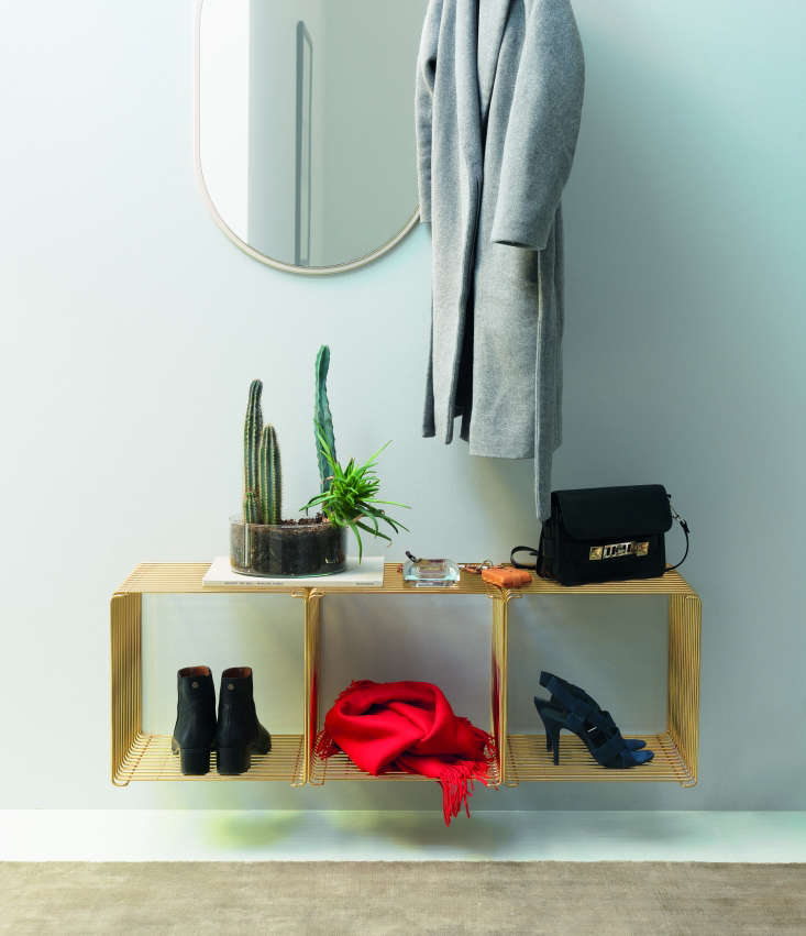 Verner Panton Wire Cube in a limited edition gold finish from Montana of Denmark used as entry storage