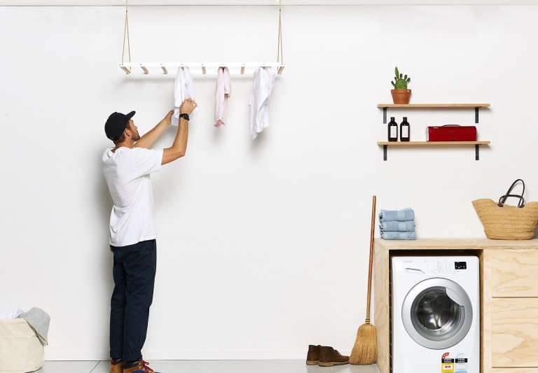The George and Willy Laundry drying rack operates on a pulley: the rack can be raised to dry clothes amid the hot air. Ideal for small-space living.