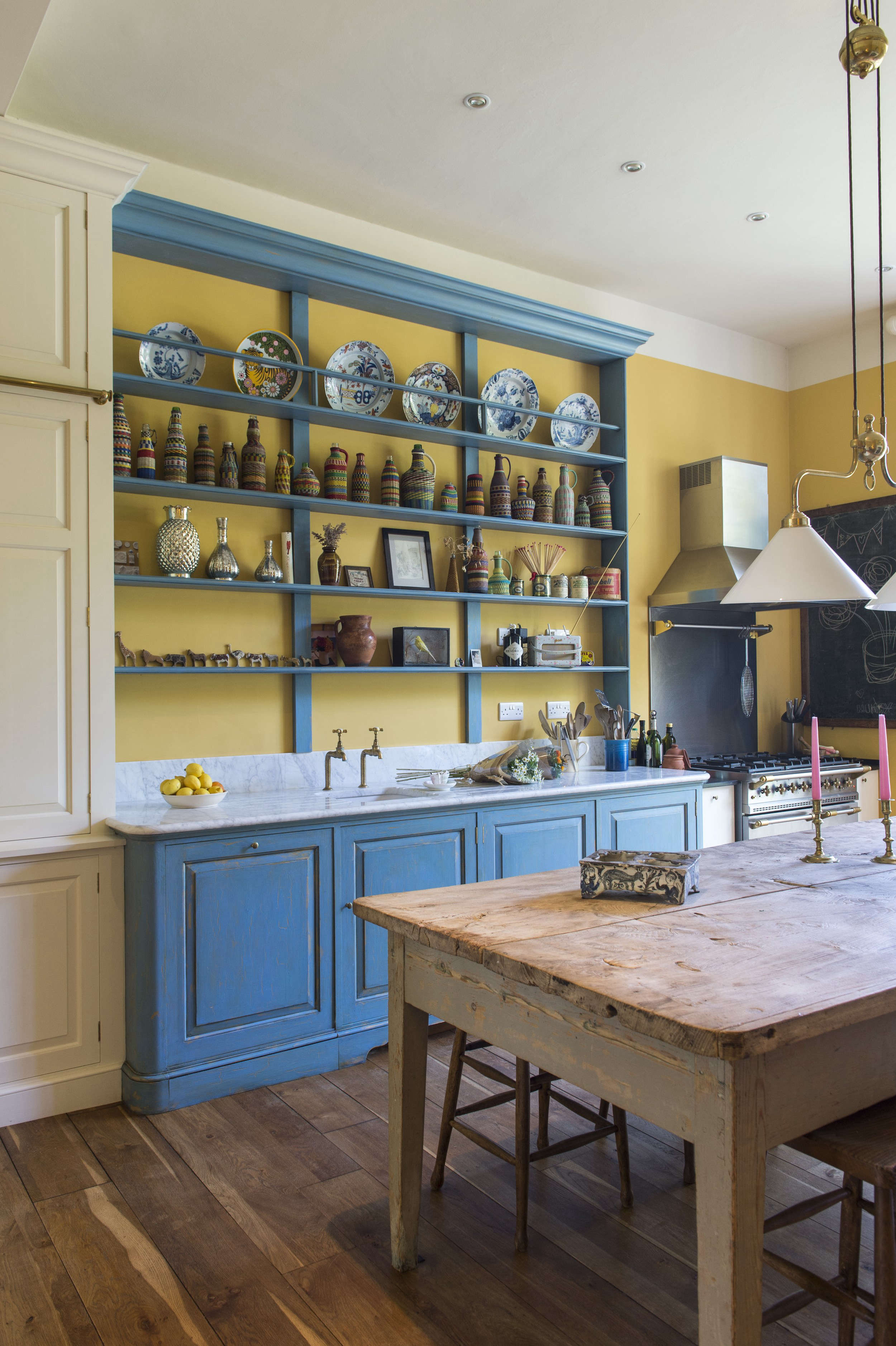 Max Rolitt UK Colorful Kitchen with Wood Table and Blue Cabinets