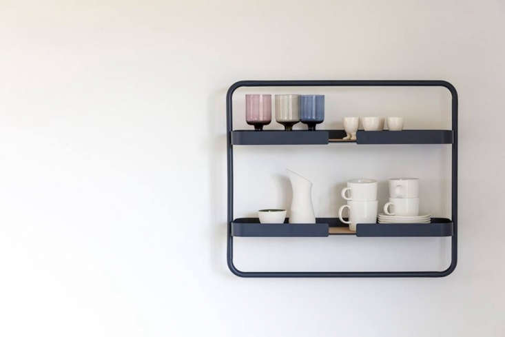 The wall-mountedShelf Lowmade of Midnight Blue or Bone (gray) powder-coated metal with a cork pad.