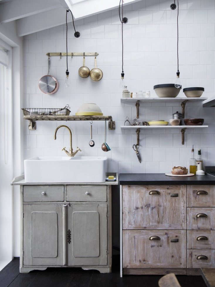 A wall-mounted dish drainer in a kitchen my Mark Lewis; see more at Custom Cast-Bronze Hardware from Mark Lewis in Londonin.