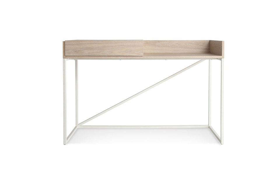 TheSwish Console Desk from Minneapolis-based Blu Dot has a sliding compartment to contain chargers and desk accessories, plus a cutout hole underneath so cords can reach the power supply. Made of powder-coated steel with a wood veneer top, the desk starts at $699 for the ash/white combination shown here.