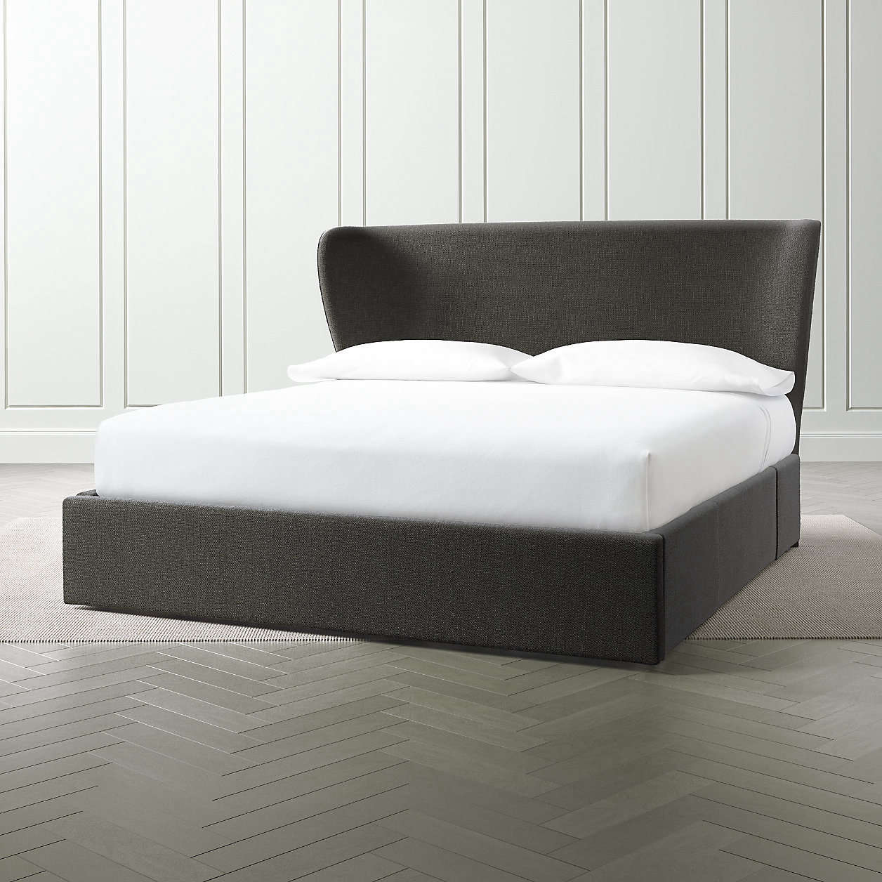 Crate & Barrel carries a range of storage beds, including this one, the Carlie Queen Wingback Headboard with Upholstered Storage Base, which is available in multiple colors (pictured in Samba Carbon) and sizes. The base features three drawers: one at the foot of the bed, and one on each side. The queen size is $2,098.