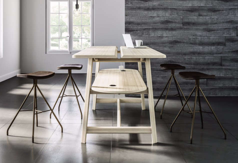 """HBF partnered with Oregon's Studio Gorm to create the Studio Rectangular Standing Height Table, which """"accommodates technology without dictating function."""" It has a storage shelf for chargers, and either holes through which cords can reach an outlet or an actual power outlet embedded in the table. It's priced starting at $8,800."""