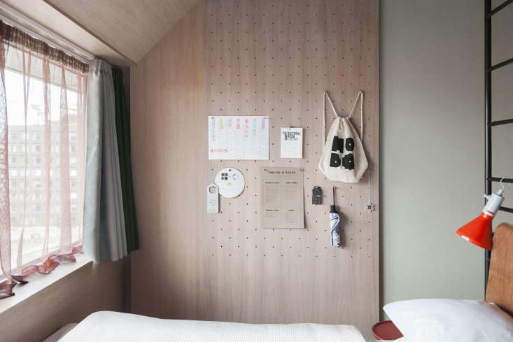 Guest room pegboard at Hobo Hotel Stockholm designed by Studio Aisslinger. Patricia Parinejad photo.