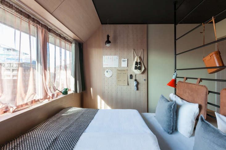 Clever use of tiny bedroom: Hobo Hotel Stockholm designed by Studio Aisslinger. Patricia Parinejad photo.