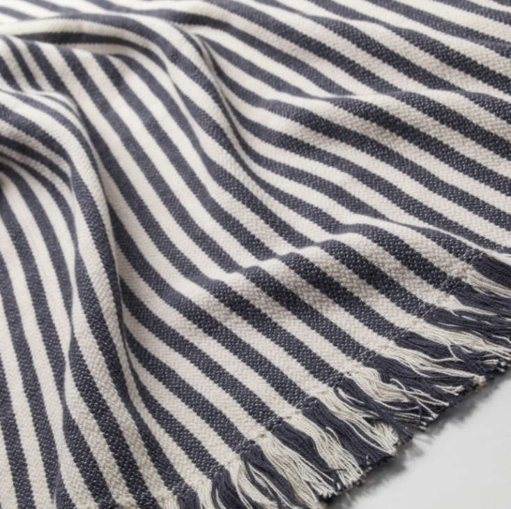 Another winner in Ikea's lineup of affordable throws (we miss the now-retired Backvial): TheTuvalie 100 percent cotton throw is available in dark gray or red stripe; $12.99.