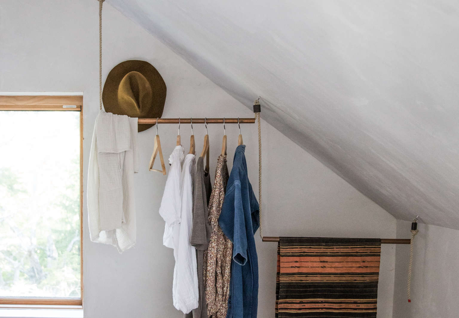DIY Clothes Rack Closet in Soot House by Anthony Esteves, Photo by Greta Rybus