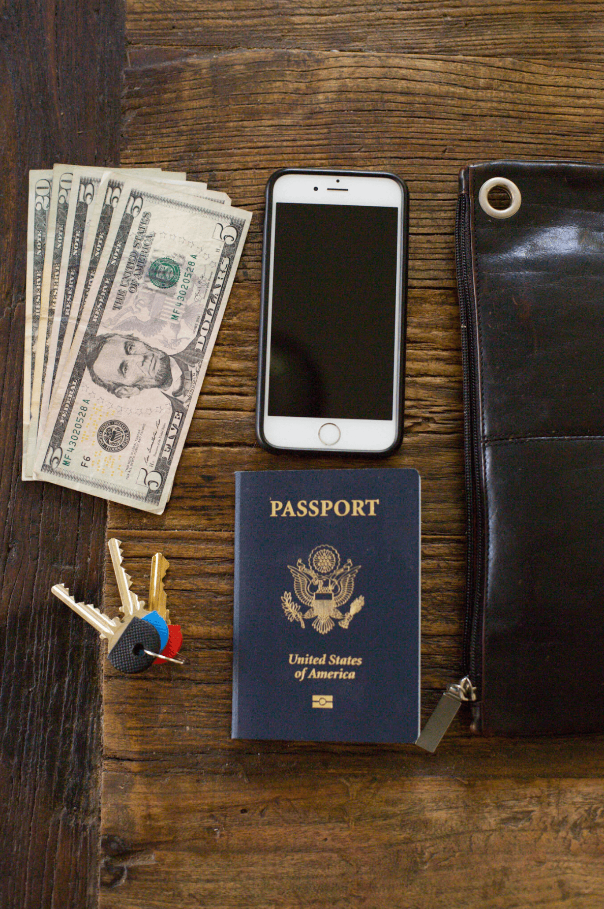 I keep a large wallet (which can double as a handbag) tucked in an inside pocket of the backpack. For a similar wallet, consider a 10.5-inch-long Black Leather Clutch Bag with a wrist strap ($105 from ThePurseCo via Etsy).