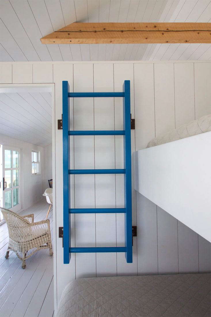 Blue Ladder on Wall in Falmouth Cottage, Photo by Justine Hand