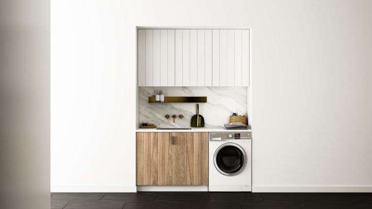 Compact laundry room design by Fisher & Paykel fitted with the brands's combination washer-dryer.