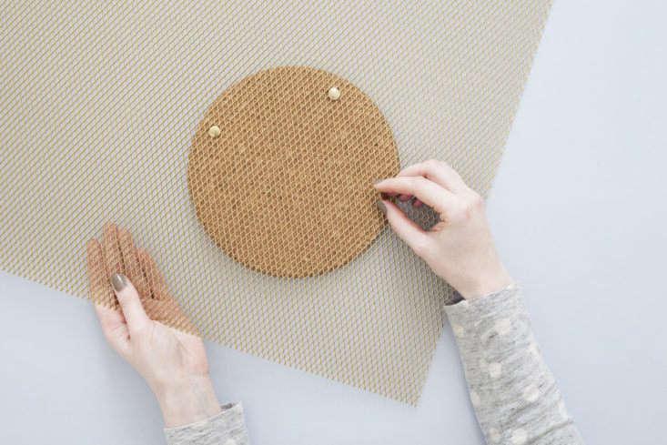 Heju DIY metal wall organizer in progress: affixing the cork trivet.