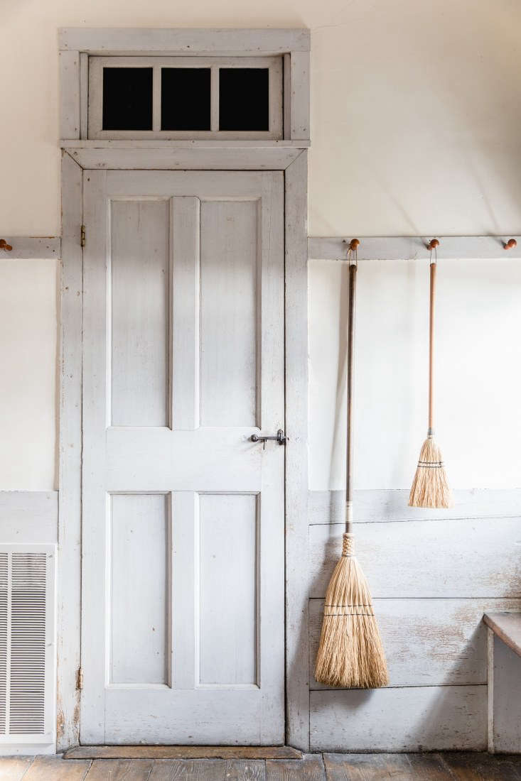 Hanging Brooms at Canterbury Shaker Village, Photo by Erin Little