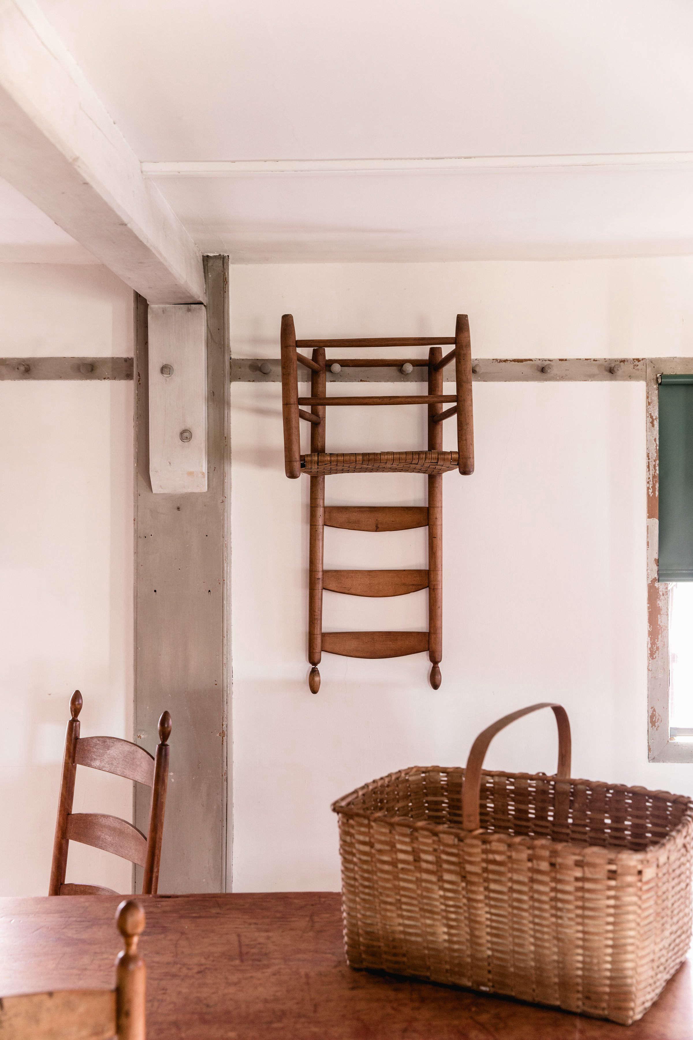 Chair on Peg Rail at Canterbury Shaker Village, Photo by Erin Little