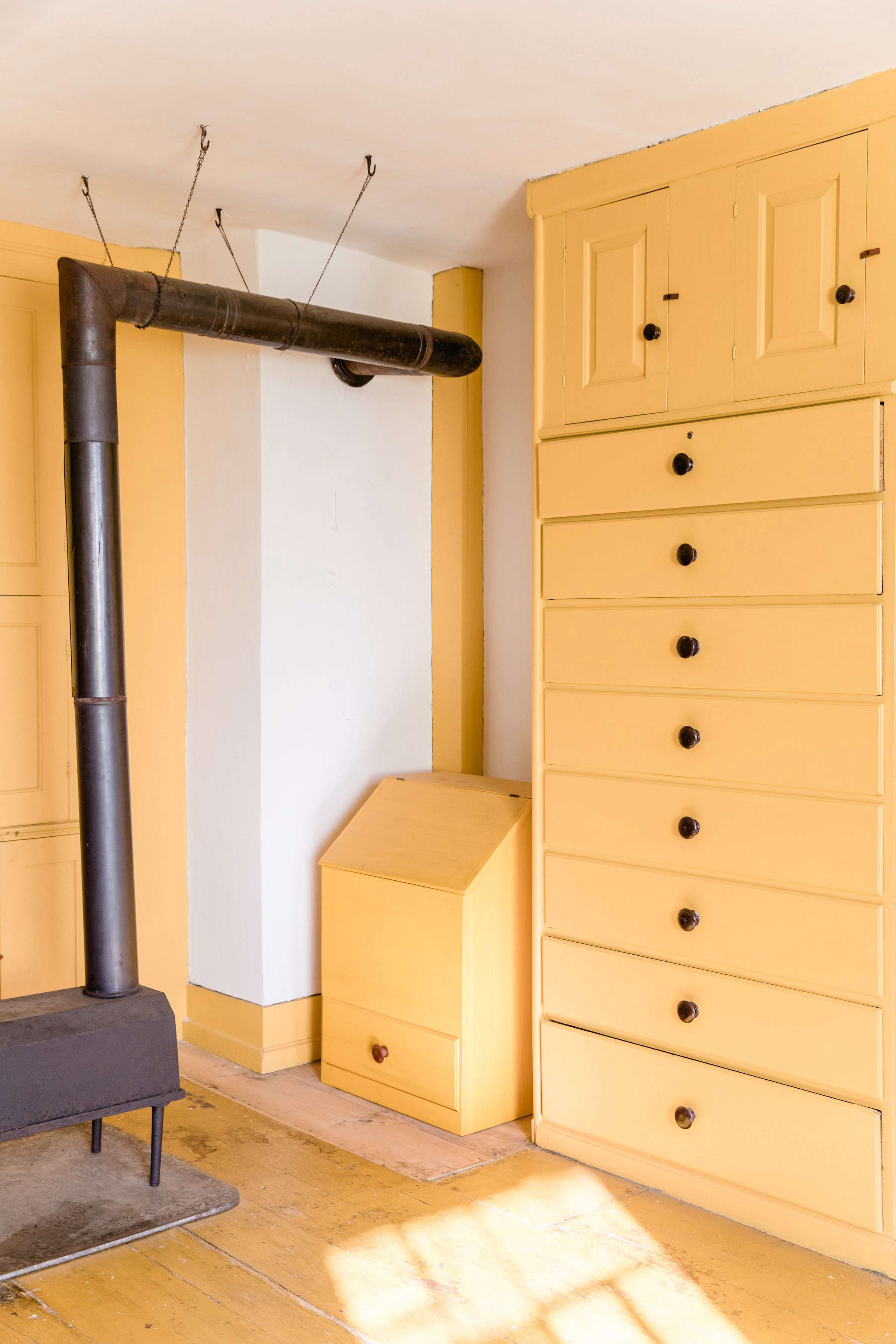 Yellow Cabinetry at Canterbury Shaker Village, Photo by Erin Little