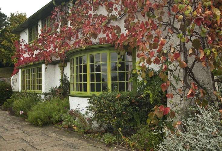 Perrycroft facade with green paint and stucco in Autumn in Malvern by Jim Powell